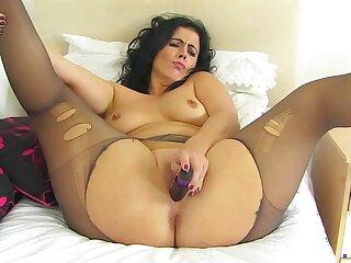Spanish milf Montse Swinger fucks nyloned cunt with dildo
